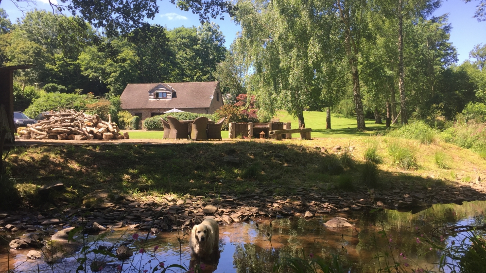 Forest Mill Holiday Cottage in the Brecon Beacons viewed from the River Monnow