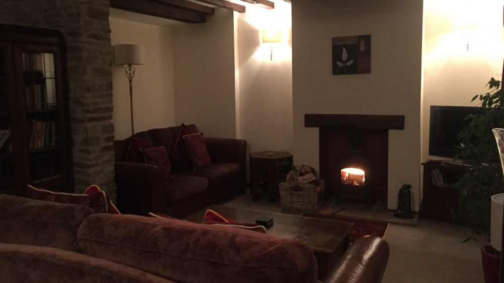 Cosy sitting room in Forest Mil Cottage warm up after a day in the Brecon Beacons