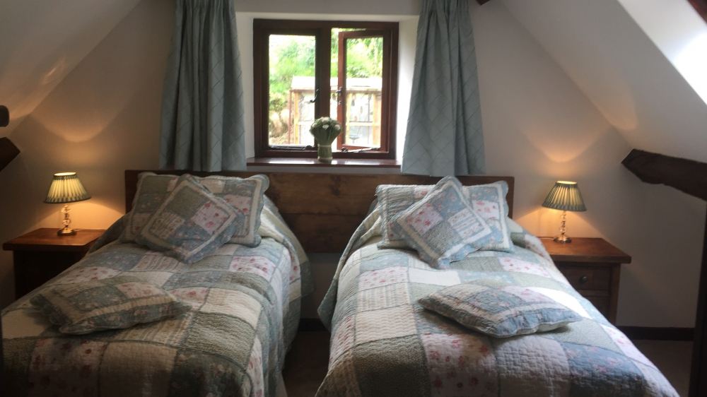 The Hobbit Room twin beds at Forest Mill Cottage
